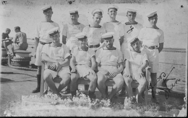 Back: br AB Frederick Windsor RN br AB George Dennison - New Zealand br  AB Joc Smith RN br  AB Eric Haines South African Navy br  AB Stanley Kingdon - New Zealand br  Boy Seaman Edgar Holden RN aged 17 br  \nFront: br  AB Ross Buckley - New